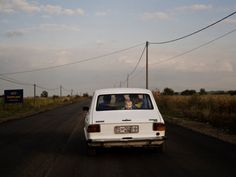 """20aliens: """" SERBIA. 2008. A boy rides with his family in a Zastava 101 which is a Serbian made car. Christopher Anderson """""""
