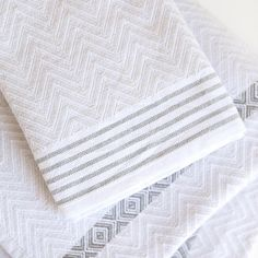 The Tawulo is a classic and original addition to the Mungo flat-weave towel range. This textured, monochrome range is punctuated with a few bold pops of colour in the striped details. One of the defining characteristics is that no two Tawulo's are the same, thanks to the random rolling of the weft yarn in the weaving process. Guest Towels, Hand Towels, Weaving Process, Bath Sheets, Turkish Towels, Charcoal Color, Color Pop, Colour, Folded Up