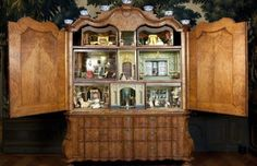 The Hague's Municipal Museum is hosting an exhibition that is presenting the dolls house craze and the fascination for the world in miniature.