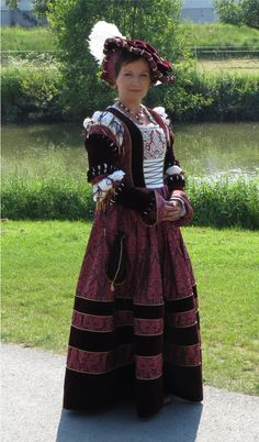 """16th century saxon court gown. "" The piping around the stripes really makes them pop"