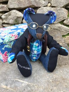 Memory Bear for the love of a husband and dad. The memories completed by his blazer, glasses and gift box.
