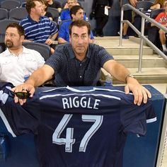Rob Riggle sitting front row at Sporting Park.