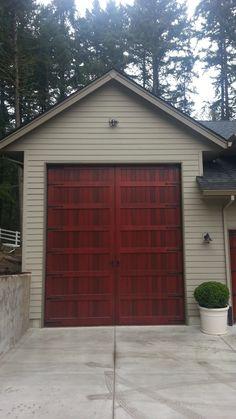 Regular look garage door opens to a motor home garage for Rv garage door