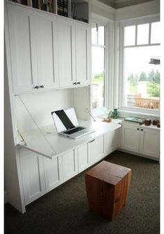 built in bookcases around window and murphy desk - Google Search