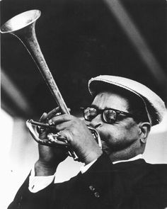His idiosyncratic beret, horn-rimmed glasses, bent horn, pouched cheeks and scat singing helped popularize bebop. Music Is Life, New Music, Charles Mingus, Dizzy Gillespie, Diana Krall, Musician Photography, Thelonious Monk, Afro Cuban, Louis Armstrong