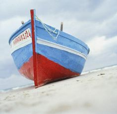 Red white & blue rowboat on the beach