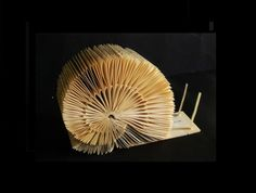 Snail made out of book pages | clara maffei