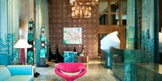 Kelly Wearstler's influence is seen in the copper-brushed mirrors and floating chandeliers in the lobby. #Jetsetter