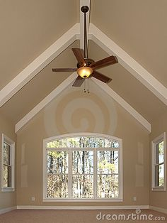 Neutral plus white beams vaulted ceiling