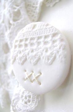 White ornate lace button .