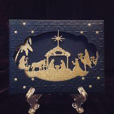 Nativity scene for Christmas, Night of navy card stock, Cuttlebug Baby's Breathe Embossing folder, gold glitter paper, Taylored Expression Nativity Border die, Stampin Up Apothecary Accents