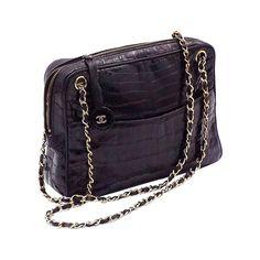 Chanel Vintage Crockodile Alligator Black shoulder bag  | From a collection of rare vintage shoulder bags at https://www.1stdibs.com/fashion/handbags-purses-bags/shoulder-bags/