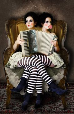 Siamese Twins :: This is an exceptional photograph! However, If they're genuine siamese twins, I'll eat that accordion! LOL