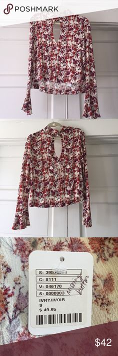 Free People Floral Blouse Really cute floral print Boise from Free People. Deep v cut in front and semi open back. Missing one button on the back (pictured) Free People Tops Blouses
