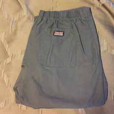 Cherokee scrub bottom, small In great condition. Has elastic band in back with tie in front. Waist measures 16 inches with inseam measuring 32 inches. Has the two side pockets with the pocket in the back. 3 inch slit on bottom of pants. Any questions please let me know. Cherokee Pants