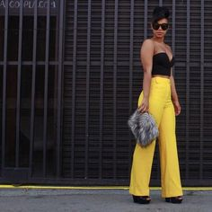 Make your solids make a statement with yellow trousers that pop, like fashionista Carmen Alexandra.