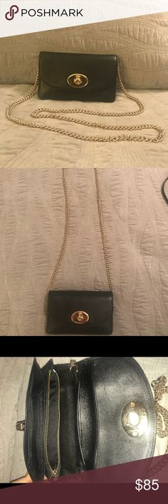 NEVER USED Coach cross body clutch I never used this once but removed the tags thinking I would. This black leather beauty can be used as a cross body purse with the gold chain strap. Remove it when you want an elegant clutch for a night out, or use it as your everyday purse/wallet! Featuring tons of compartments, zippers, and card pockets - Coach really maximized every bit of space to keep all of your items organized.   JUST LIKE NEW! This is one purse that will never go out of style…