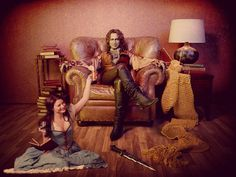 Rumpelstiltzken and Belle from Once Upon A Time. Best part of this picture: Gold knitting.
