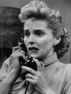 "Actress, Susan Douglas, looking very worried as she talks over the phone in her part as Kathy Roberts, in TV soap opera ""The Guiding Light."" Taken March 1954 by Walter Sanders"