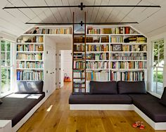 built in sofas that double as twin beds for guests. Drawers under the sofas hold children's toys and a wall of shelves houses books and more
