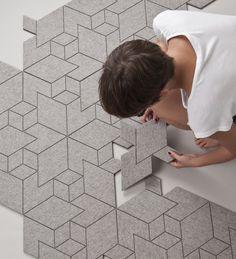 Geometric felt & rubber carpet tiles.