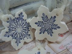 Beautiful and understated, this set of three ceramic snowflake ornaments have been glazed in a smokey blue.    Entirely handmade, they measure 21/2 in diameter and are 1/4 thick. Never exactly alike because of the way they are made, I love how the glaze is heavy in some places