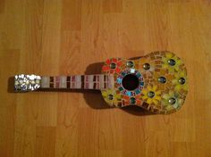 """""""Sidney's Ukele"""" mosaic on found instrument. Made this with my niece. She learned to cut glass at the age of"""