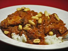 This traditional recipe from Botswana is for a classic stew of chicken cooked in a tomato, peanut butter and chili sauce. Adapted for a dinner featuring African-inspired foods. Read Recipe by Korma, Biryani, Briyani Recipe, Kwanzaa Food, Zambian Food, World Recipes, International Recipes, Soul Food, Gastronomia