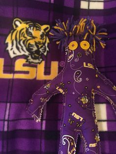 A personal favorite from my Etsy shop https://www.etsy.com/listing/247089752/lsu-dammit-doll-geaux-tigers-lsu-doll