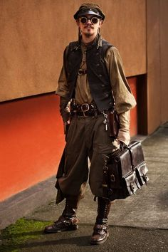 Wow, this guy just looks awesome. What a super cool outfit. This is Marcusstratus posing on the streets of Portland, OR for student photographer Anna Bart.  SteamPUNK - ☮k☮