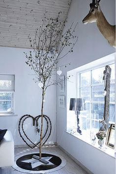 A Charlie Brown Christmas tree can become a gorgeous center piece for any room with bright and white decor.