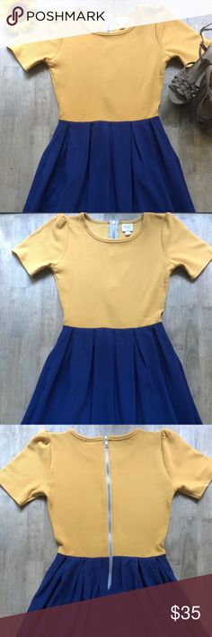 LuLaRoe Amelia Blue and Gold/Yellow Dress LuLaRoe Amelia Dress in Blue and Gold. Dress in Excellent Condition with no stains or flaws. I accept offers and all offers considered. Please check out the other items in my closet as well.  I'll add a full length photo as soon as possible. ☺️ LuLaRoe Dresses