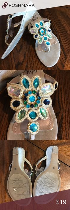 IMPO crystal sandals NWOB. Sz 7 gorgeous!! Get ready for spring! Gorgeous turquoise, teal, light green, blue, aurora borealis crystals embellish these size 7 thong , wedge heel sandals. Wedge heels are covered with slightly metallic gold fabric that shimmers. These she's were tried on in store and worn for about 5 minutes inside my home before I realized they were just too small for me. Impo Shoes Sandals