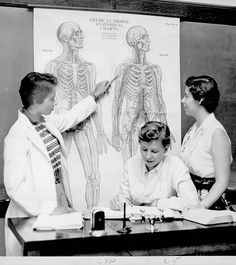 1957, New England Deaconess Hospital student nurses take an anatomy class at Simmons College.