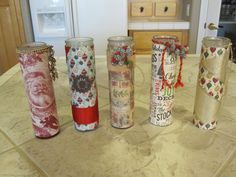 Buy a candle at the 99 cent store, cover it with Xmas scrapbook paper using Pod Modge glue and decorate with ribbons and things you have  in your Christmas craft box.