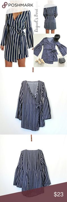 Gretchen Stripes Wrap Dress Details: Navy striped wrap tie dress with flare sleeves and asymmetrical hem  Brand: Boutique Brand  Size: Medium Measurements: Bust/34 inches Length/32 inches  Size: Large Measurements: Bust/36 inches Length/32.5 inches  Condition: New and packaged with boutique tags Dresses