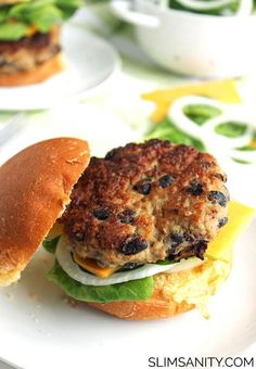 Black Bean Turkey Burgers - a hearty, delicious, and healthy alternative to a traditional burger! | slimsanity.com