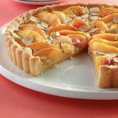 Custard Tart This great tasting peach tart combines an almond-flavored crust with peaches and sliced almonds.This great tasting peach tart combines an almond-flavored crust with peaches and sliced almonds. Peach Tart Recipes, Pie Recipes, Dessert Recipes, Cooking Recipes, Recipe Land, Shortbread Crust, Fruit Tart, Fruit Custard Tart, Cupcakes