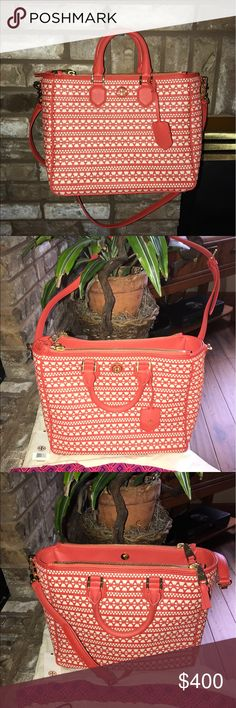 TORY BURCH ROBINSON DOUBLE-ZIP -BNWT-WOVEN CORAL This is a TORY BURCH ROBINSON DOUBLE -ZIP LARGE HAND BAG!!! It is in a SOLD OUT COLOR STYLE!! THIS IS A WOVEN PATTERN WITH CORAL COLOR LEATHER AND CREAM COLOR TO MAKE S STAMD OUT IN A CROWD PURSE😍😍😍 This purse is very large with a zippered pouch inside with extra pouches! There are 3 separate compartments two of which zipper and the middle the closes magnetically bringing the purse together. The is a ADJUSTABLE AND REMOVABLE Strap that turn…