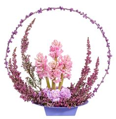 I like the shape of this arrangement....not the flowers...;