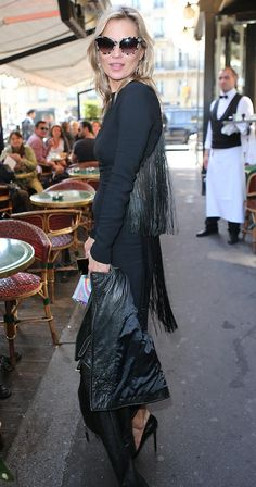 Kate Moss shows off her outfit as she attends Stella McCartney's runway show Pinterest: KarinaCamerino
