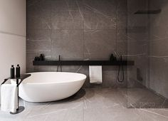 grey marbled slate, oval pebble shaped tub, glass and wood