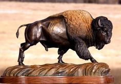 The Thunder Rolls This bronze of an American Bison running is a limited edition of 50 and stands about 12 inches tall 24 inches long.