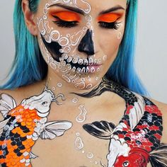 Koi Carp Bubble Skull Makeup  Looking through my @megamunden Tattoo Colouring Book I came across some cool Koi Karp and had to paint my own version and make a skull makeup out of it. I can really empathise with the challenge tattoo artists have in finding the right composition for drawing animals on the body. @sugarpill pressed eyeshadow in Flamepoint  #sugarpill #amazingmakeupart #skullmakeup #dupemag #skulltress #skullart #artoftheday #mua  #muashoutouts #faceart #facepainting #bbloger ...