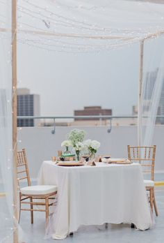 rooftop dining for two  Photography by jenniferblairphotography.com, Floral Design by flowersbyshirleyfl.com, Event Design by blog.ptinteriors.com