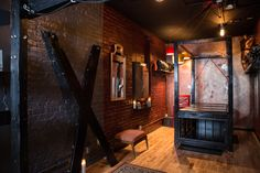 The Chamber - One of the beautiful play rooms featuring a bondage table, suspension frame and St. Andrew's Cross. This is a multi-room dungeon with hourly and overnight rentals for professional dominatrices (local and traveling), couples and photographers and also available for educational and social events. www.chicagodungeonrentals.com