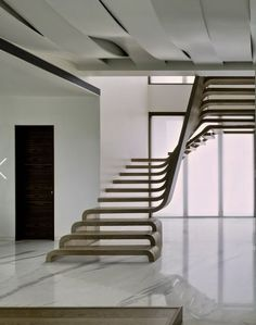 Sculpture staircase and waving ceiling with integrated lightning - SDM Apartment - Arquitectura en Movimiento Workshop #walnut #wood