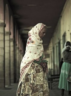 Old veiled woman in Asmara central market, Eritrea, via Flickr.