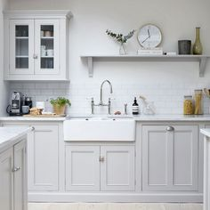 Shake up a wooden kitchen with a crisp paint job in subtlest oyster grey.