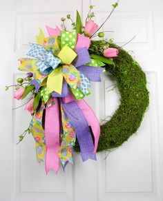 A versatile ready to use Terri Bow with Easter Accents. The Terri Bow has six different ribbons and is mixed with Easter egg picks and tulips. This is a reusable wreath accent you can place on any wre